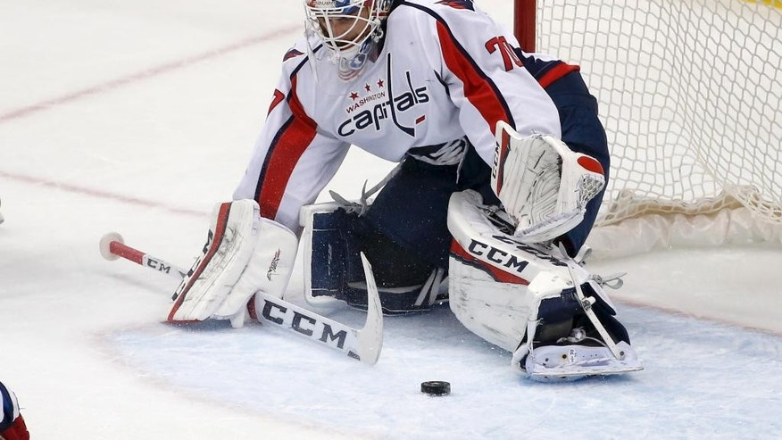 In this photo taken March 20, 2016, Washington Capitals goalie Braden Holtby (70) plays during an NHL hockey game against the Pittsburgh Penguins in Pittsburgh. Holtby is on the verge of tying Martin Brodeur's single-season record of 48 wins with time left to break it. As goalies with 40-plus-win seasons know, it takes a heavy workload, a great team and some luck to make it happen.  (AP Photo/Gene J. Puskar)