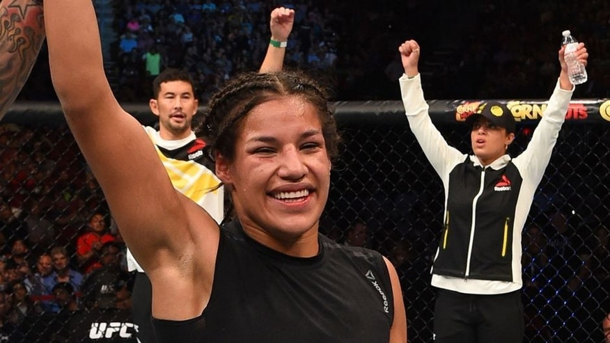 HOUSTON, TX - OCTOBER 03: Julianna Pena exchanges celebrates her victory over Jessica Eye in their women's bantamweight bout during the UFC 192 event at the Toyota Center on October 3, 2015 in Houston, Texas. (Photo by Josh Hedges/Zuffa LLC/Zuffa LLC via Getty Images)