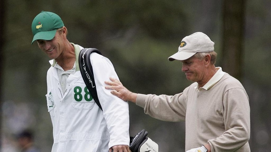 FILE - In this April 9, 2005, file photo, Jack Nicklaus, right, walks with his son and caddie, Jack Nicklaus II, on the ninth hole during second round play of the Masters golf tournament at the Augusta National Golf Club in Augusta, Ga. Nicklaus' oldest son caddied for him at the 1986 Masters, when the older Nicklaus _ then 46 _ made one of the most unlikely  comebacks in major history. (AP Photo/Amy Sancetta, File)
