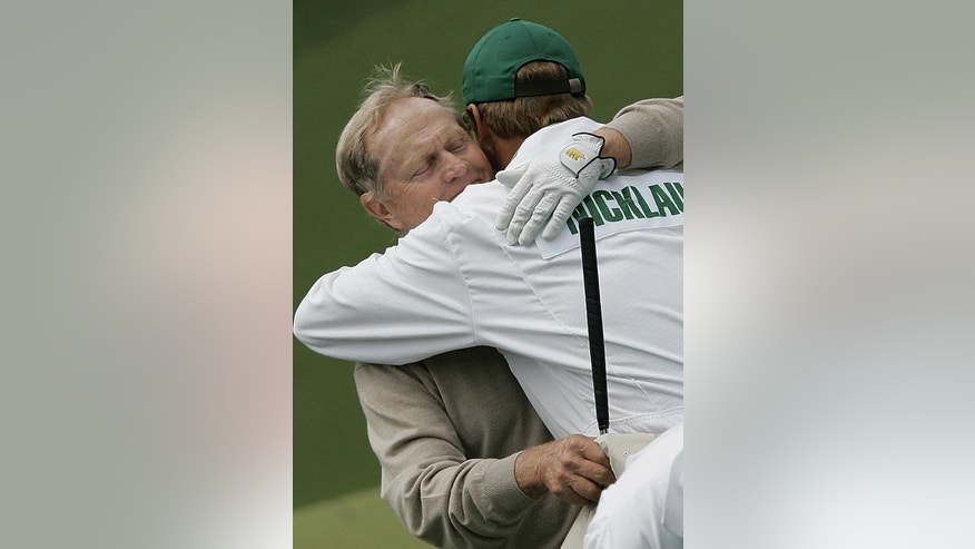 FILE - In this April 9, 2005, file photo, Jack Nicklaus is hugged by his son and caddy, Jack Nicklaus II, after he completed his second round play of the 2005 Masters at the Augusta National Golf Club in Augusta, Ga. Nicklaus' oldest son also caddied for him at the 1986 Masters, when the older Nicklaus _ then 46 _ made one of the most unlikely comebacks in major history. (AP Photo/Elise Amendola, File)