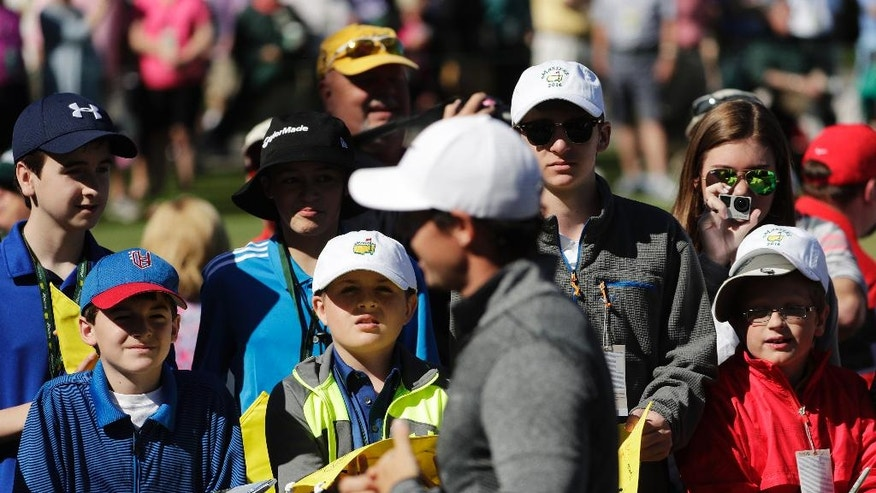 Rory McIlroy, of Northern Ireland, walks past spectators during a practice round for the Masters golf tournament, Monday, April 4, 2016, in Augusta, Ga. (AP Photo/Chris Carlson)