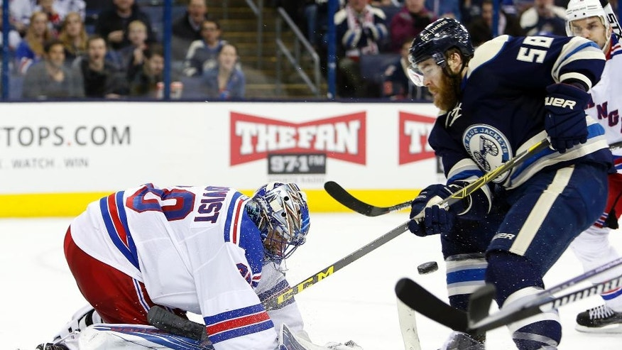New York Rangers' Henrik Lundqvist, left, of Sweden, makes a save against Columbus Blue Jackets' David Savard during the second period of an NHL hockey game Monday, April 4, 2016, in Columbus, Ohio. (AP Photo/Jay LaPrete)