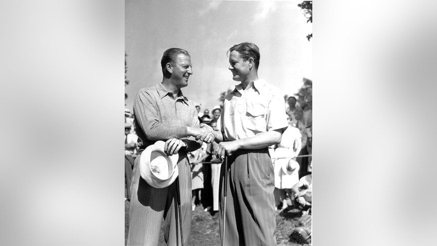 FILE - In this June 12, 1939, file photo, Byron Nelson, right, of Reading, Pa., shakes hands with Craig Wood of Mamaroneck, N.Y., before teeing off during the National Open Golf Championships in Philadelphia. Nelson won with a score of 70 to Wood's 73 at the Philadelphia Spring Mill course. Wood endured more heartache in the majors than anyone before he finally won.  (AP Photo/File)
