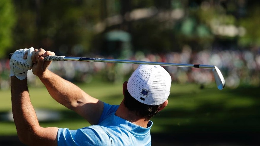 Rory McIlroy, of Northern Ireland, watches his tee shot on the sixth hole during a practice round for the Masters golf tournament, Tuesday, April 5, 2016, in Augusta, Ga. (AP Photo/Charlie Riedel)