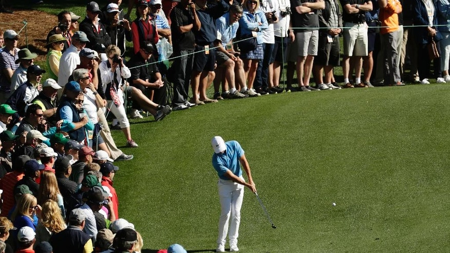 Rory McIlroy, of Northern Ireland, chips to the sixth green during a practice round for the Masters golf tournament, Tuesday, April 5, 2016, in Augusta, Ga. (AP Photo/Charlie Riedel)
