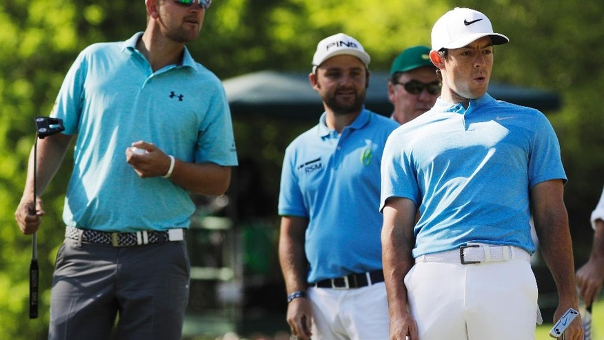 From left, Bernd Wiesberger, of Austria, Andy Sullivan, of England, and Rory McIlroy, of Northern Ireland, react to McIlroy's putt on the sixth hole during a practice round for the Masters golf tournament, Tuesday, April 5, 2016, in Augusta, Ga. (AP Photo/Jae C. Hong)