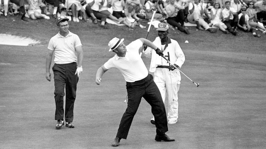 FILE - In this April 11, 1965 file photo, Jack Nicklaus prepares to toss his ball down the fairway after he putted out to win the Masters Championship at Augusta National Golf Club in Augusta, Ga. Nicklaus was tied with Gary Player and Arnold Palmer after 36 holes and wound up winning by nine shots over both of them. He set the tournament record at 271. (AP Photo/File)