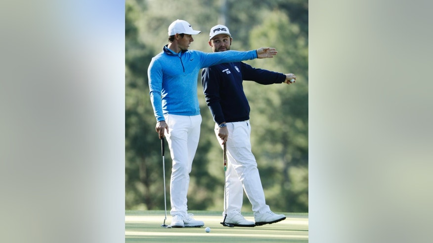 Rory McIlroy, of Northern Ireland, discusses the third green with Andy Sullivan, of England, during a practice round for the Masters golf tournament, Tuesday, April 5, 2016, in Augusta, Ga. (AP Photo/Charlie Riedel)