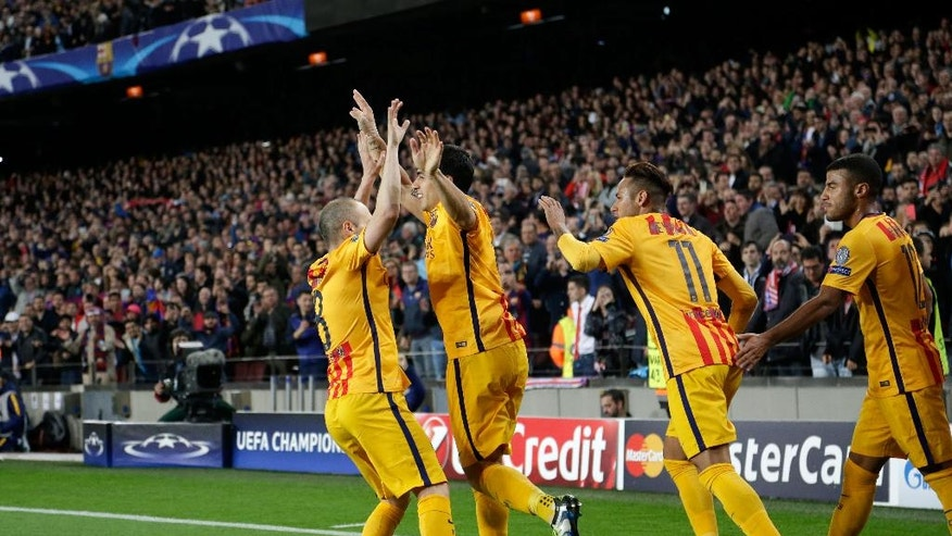 Barcelona's Luis Suarez, 2nd left, celebrates after scoring his side's second goal during a Champions League quarter-final, first leg soccer match between FC Barcelona and Atletico Madrid at the Camp Nou stadium in Barcelona, Spain, Tuesday April 5, 2016. (AP Photo/Emilio Morenatti)
