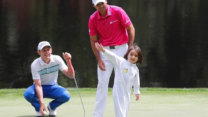 Jason Day, of Australia's son Dash celebrates after putting on the ninth hole during the par three competition at the Masters golf tournament Wednesday, April 6, 2016, in Augusta, Ga. (AP Photo/Jae C. Hong)