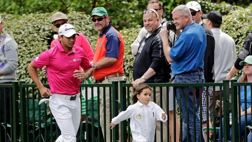 Jason Day, of Australia, runs with son Dash during the par three competition at the Masters golf tournament Wednesday, April 6, 2016, in Augusta, Ga. (AP Photo/Jae C. Hong)