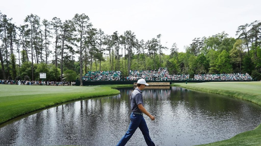 Jordan Spieth walks along the 15th fairway during a practice round at the Masters golf tournament Wednesday, April 6, 2016, in Augusta, Ga. (AP Photo/Matt Slocum)