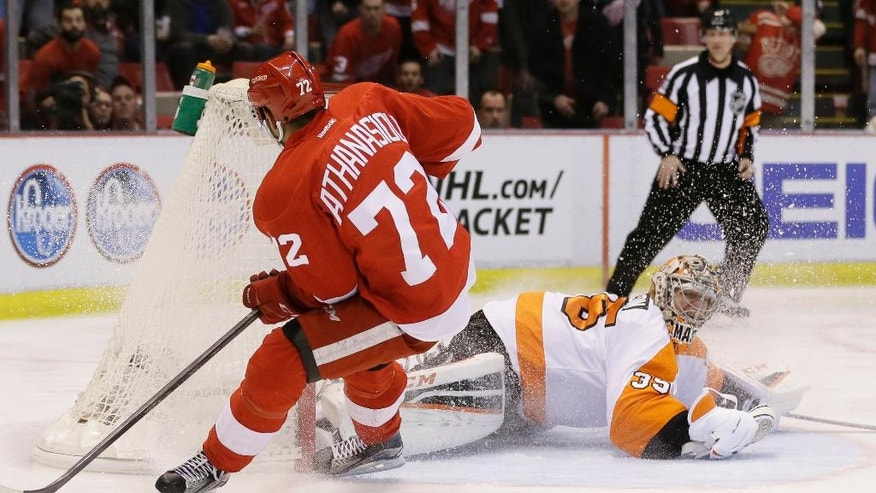 Detroit Red Wings center Andreas Athanasiou (72) scores on Philadelphia Flyers goalie Steve Mason (35) during the second period of an NHL hockey game, Wednesday, April 6, 2016, in Detroit. (AP Photo/Carlos Osorio)
