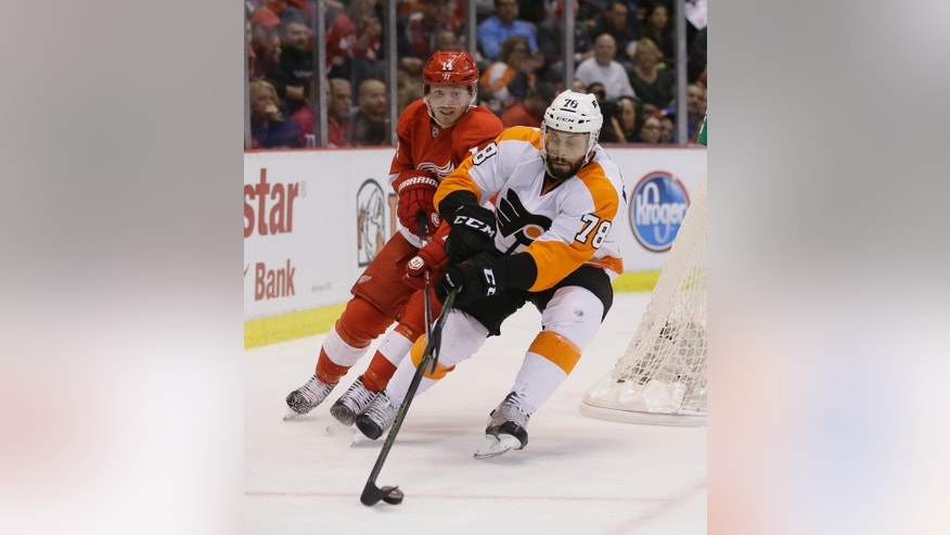 Philadelphia Flyers right wing Pierre-Edouard Bellemare (78) controls the puck ahead of Detroit Red Wings center Gustav Nyquist (14), of Sweden, during the second period of an NHL hockey game, Wednesday, April 6, 2016, in Detroit. (AP Photo/Carlos Osorio)