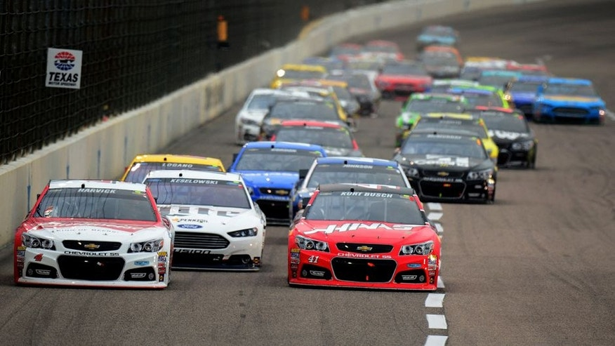 FORT WORTH, TX - APRIL 11: Kevin Harvick, driver of the #4 Budweiser/Jimmy John's Chevrolet, and Kurt Busch, driver of the #41 Haas Automation Chevrolet, lead the field during the NASCAR Sprint Cup Series Duck Commander 500 at Texas Motor Speedway on April 11, 2015 in Fort Worth, Texas. (Photo by Robert Laberge/Getty Images for Texas Motor Speedway)