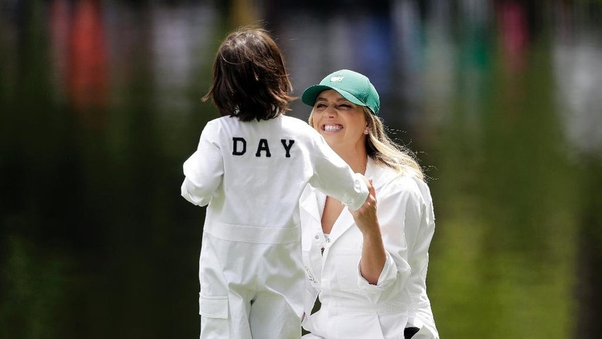 Jason Day, of Australia's wife Ellie Harvey talks to their son Dash on the ninth hole during the par three competition at the Masters golf tournament Wednesday, April 6, 2016, in Augusta, Ga. (AP Photo/Jae C. Hong)