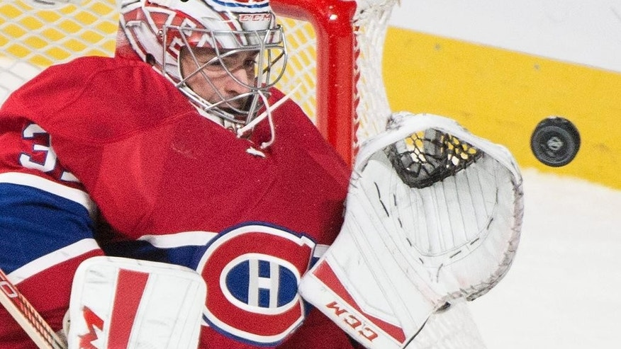 FILE - In this Oct. 20, 2015, file photo, Montreal Canadiens goaltender Carey Price makes a save against the St. Louis Blues during the third period of an NHL hockey game, in Montreal. The Montreal Canadiens say goaltender Carey Price and defenseman P.K. Subban will not play in the final two games of the season. The club revealed Price has been out with a sprained medial collateral ligament sprain in his right knee suffered Nov. 25 against the New York Rangers. Subban, Montreal's top defenseman, has been out since suffering a neck injury March 10 against Buffalo.(Graham Hughes/The Canadian Press via AP, File) MANDATORY CREDIT