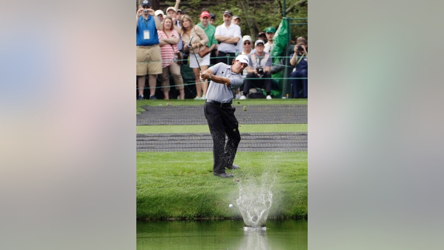FILE - In this April 8, 2015, file photo, Phil Mickelson skips a ball across the water hole on the 16th fairway during a practice round for the Masters golf tournament in Augusta, Ga. For many, the 16th hole is the place to be before the first major of the year gets going for real, a chance to watch everyone from the biggest names in golf to unknown amateurs attempt to skip the ball off the water–the more times, the better–and land it safely on the green.It's a technique roughly akin to throwing a smooth rock across a glassy pond. (AP Photo/David J. Phillip, File)