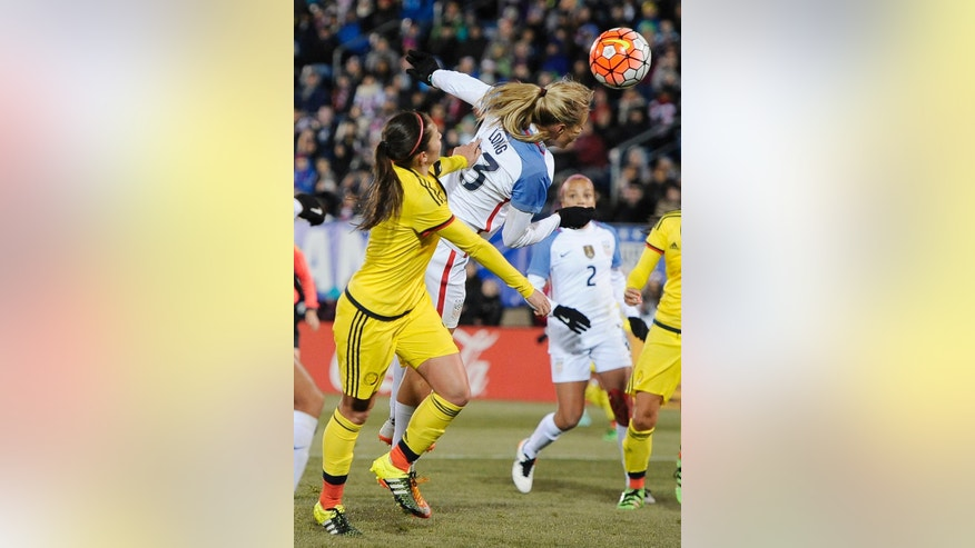 United States' Allie Long, scores a goal as Colombia's Natalia Gaitan, left, defends during the first half of an international friendly soccer match Wednesday, April 6, 2016, in East Hartford, Conn. (AP Photo/Jessica Hill)