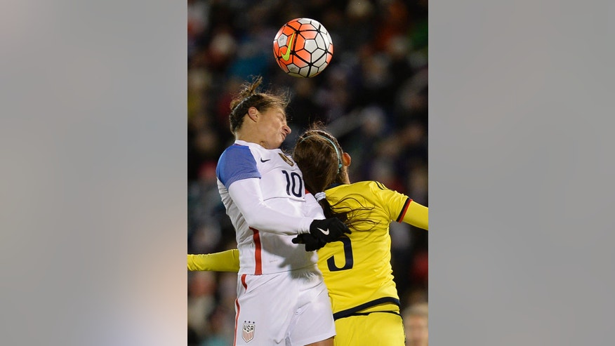 United States' Carli Lloyd (10) heads the ball toward the goal as Colombia's Isabella Echeverri defends during the second half of an international friendly soccer match at Pratt & Whitney Stadium at Rentschler Field, Wednesday, April 6, 2016, in East Hartford, Conn. The United States won 7-0. (AP Photo/Jessica Hill)