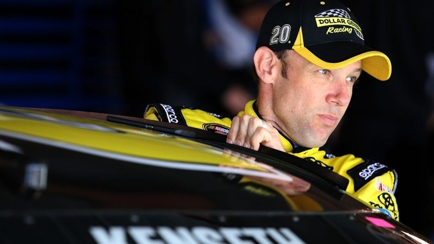 MARTINSVILLE, VA - APRIL 02: Matt Kenseth, driver of the #20 Dollar General Toyota, climbs into his car during practice for the NASCAR Sprint Cup Series STP 500 at Martinsville Speedway on April 2, 2016 in Martinsville, Virginia. (Photo by Sean Gardner/NASCAR via Getty Images)