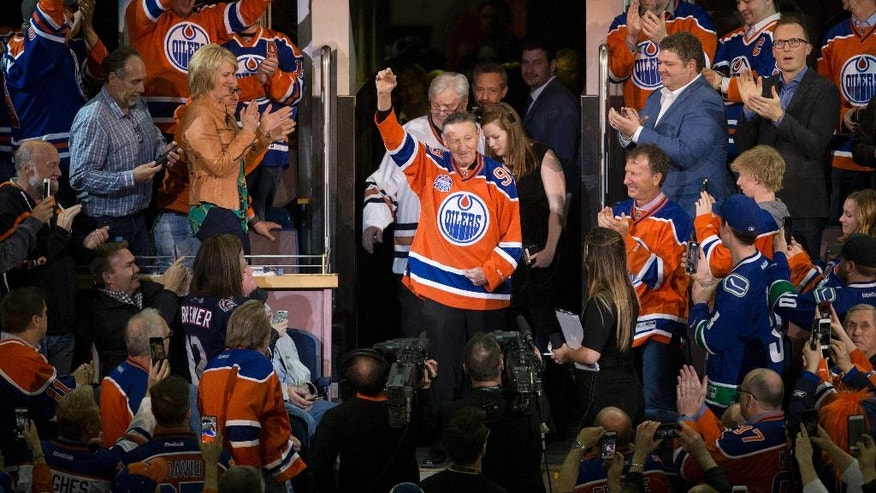 Walter Gretzky is honored during an NHL hockey game between the Edmonton Oilers and the Vancouver Canucks on Wednesday, April 6, 2016, in Edmonton, Alberta. The Oilers won 6-2. (Jason Franson/The Canadian Press via AP)