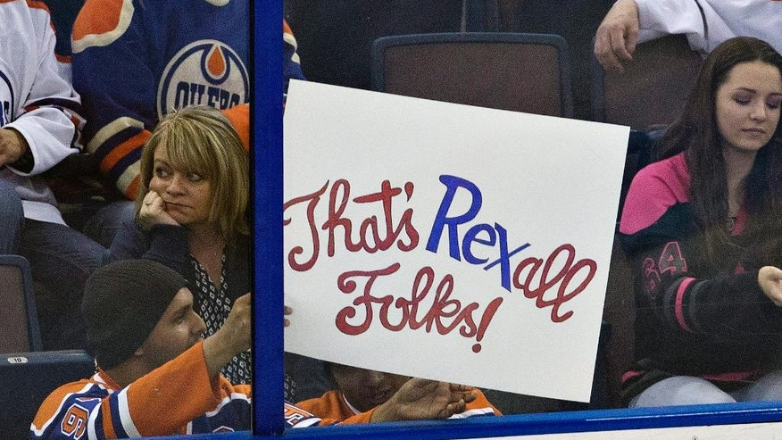 A fan shows holds a sign as he watches the final NHL hockey game at Rexall Place, between the Vancouver Canucks and the Edmonton Oilers, during the second period Wednesday, April 6, 2016, in Edmonton, Alberta. (Jason Franson/The Canadian Press via AP)
