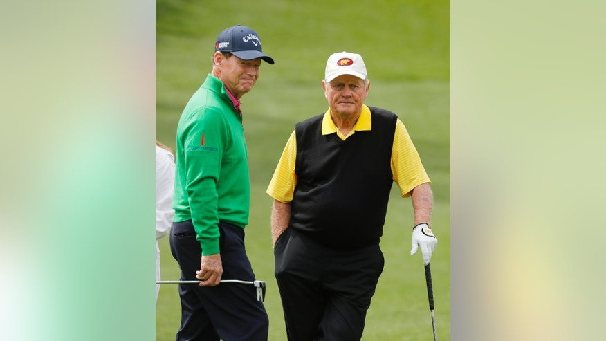 Tom Watson, left, talks to Jack Nicklaus on the second hole during the par three competition at the Masters golf tournament Wednesday, April 6, 2016, in Augusta, Ga. (AP Photo/Chris Carlson)
