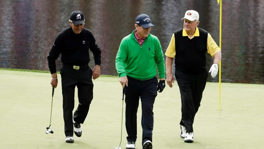 From left, Gary Player, Tom Watson and Jack Nicklaus walk off the eighth hole during the par three competition at the Masters golf tournament Wednesday, April 6, 2016, in Augusta, Ga. (AP Photo/Charlie Riedel)