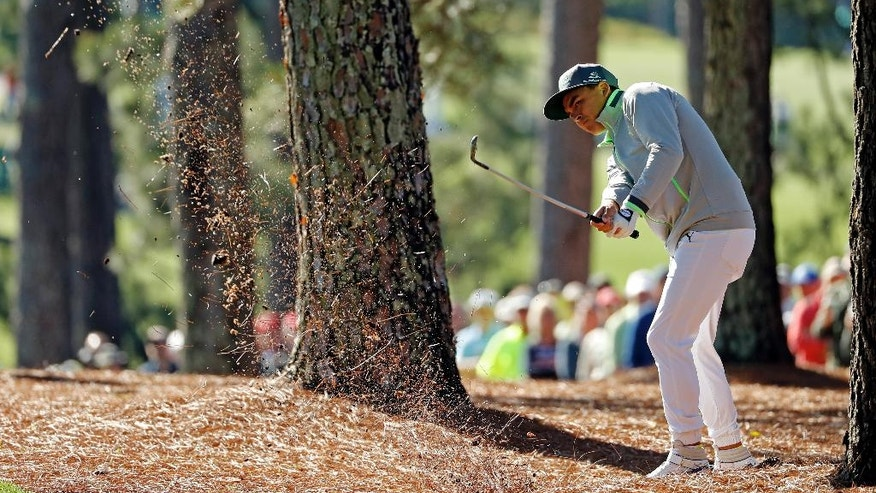 Rickie Fowler hits out of the rough off the first fairway during the first round of the Masters golf tournament Thursday, April 7, 2016, in Augusta, Ga. (AP Photo/Matt Slocum)
