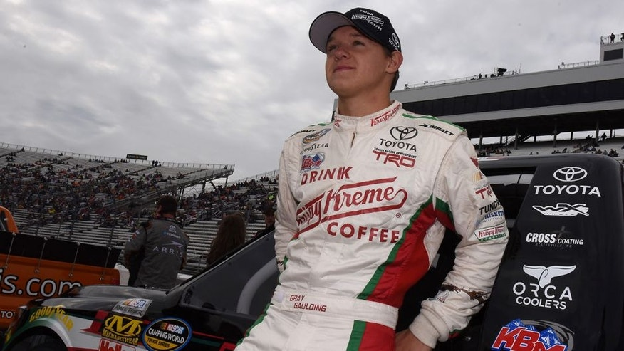 MARTINSVILLE, VA - OCTOBER 31: Gray Gaulding, driver of the #54 Krispy Kreme Toyota, stands on the grid during pre-race ceremonies for the NASCAR Camping World Truck Series Kroger 200 at Martinsville Speedway on October 31, 2015 in Martinsville, Virginia. (Photo by Jonathan Moore/Getty Images)