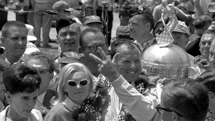 FILE - In this May 31, 1967, file photo, A.J. Foyt holds up three fingers in the winner's circle, celebrating his third Indianapolis 500 win,  at Indianapolis Motor Speedway in Indianapolis, Ind.  (AP Photo/File)