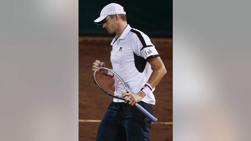 John Isner, of the United States, celebrates a point against Denis Kudla, of the United States, at the U.S. men's clay court tennis championships Wednesday, April 6, 2016, in Houston. (Michael Ciaglo/Houston Chronicle via AP)