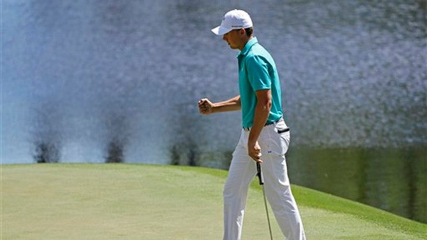 Jordan Spieth punches the air after saving par on the 16th hole during the first round of the Masters golf tournament Thursday, April 7, 2016, in Augusta, Ga. (AP Photo/Jae C. Hong)