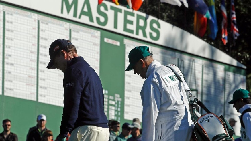 Tom Watson walks up the first fairway with his caddie Neil Oxman during the first round of the Masters golf tournament Thursday, April 7, 2016, in Augusta, Ga. (AP Photo/Charlie Riedel)
