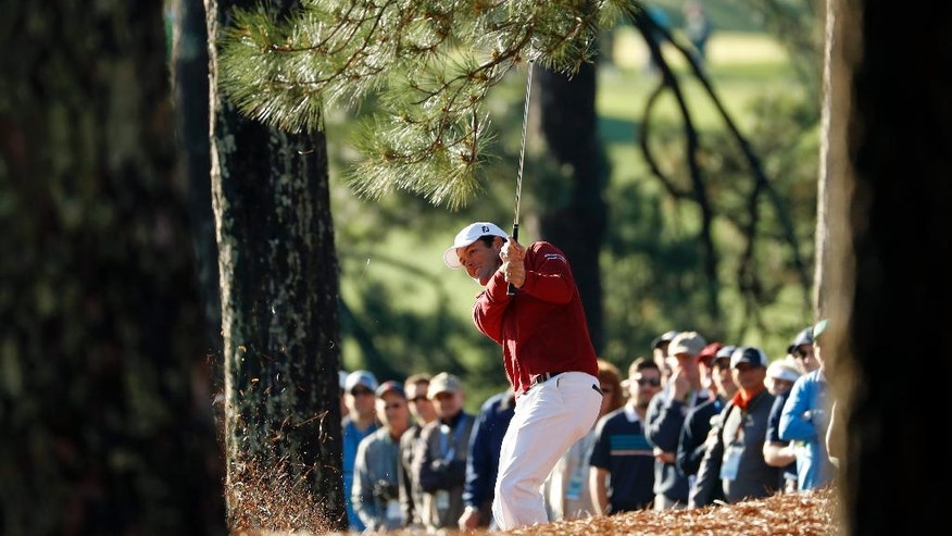 Robert Streb hits out of the rough on the first fairway during the first round of the Masters golf tournament Thursday, April 7, 2016, in Augusta, Ga. (AP Photo/Matt Slocum)