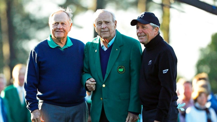 From left, Jack Nicklaus, Arnold Palmer and Gary Player pose during the ceremonial first tee before the first round of the Masters golf tournament Thursday, April 7, 2016, in Augusta, Ga. (AP Photo/Matt Slocum)
