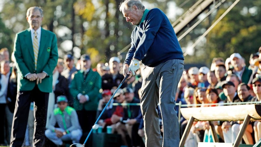 Jack Nicklaus hits a ceremonial first tee before the first round of the Masters golf tournament Thursday, April 7, 2016, in Augusta, Ga. (AP Photo/David J. Phillip)