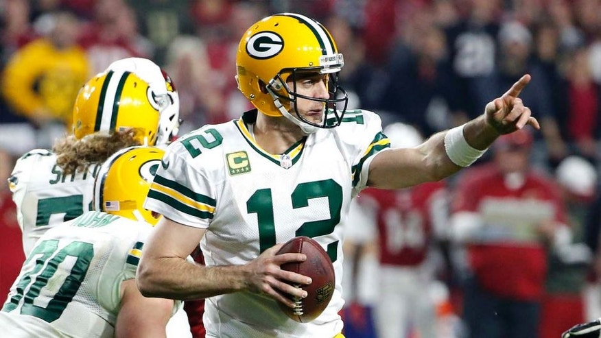 Green Bay Packers quarterback Aaron Rodgers points to a receiver during the second half of a playoff game against the Arizona Cardinals on Saturday, Jan. 16, 2016, in Glendale, Ariz.