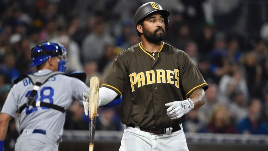 SAN DIEGO, CALIFORNIA - APRIL 05: Matt Kemp #27 of the San Diego Padres flips his bat after striking out during the seventh inning of a baseball game against the Los Angeles Dodgers at PETCO Park on April 5, 2016 in San Diego, California. (Photo by Denis Poroy/Getty Images)