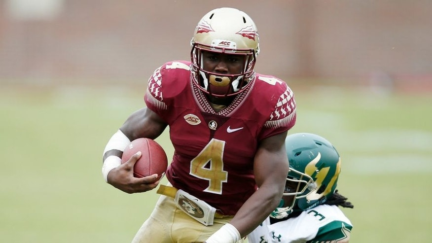 Dalvin Cook #4 of the Florida State Seminoles runs the ball against Deatrick Nichols #3 of the South Florida Bulls during the game at Doak Campbell Stadium on September 12, 2015 in Tallahassee, Florida. Florida State defeated South Florida 34-14. (Photo by Joe Robbins/Getty Images)