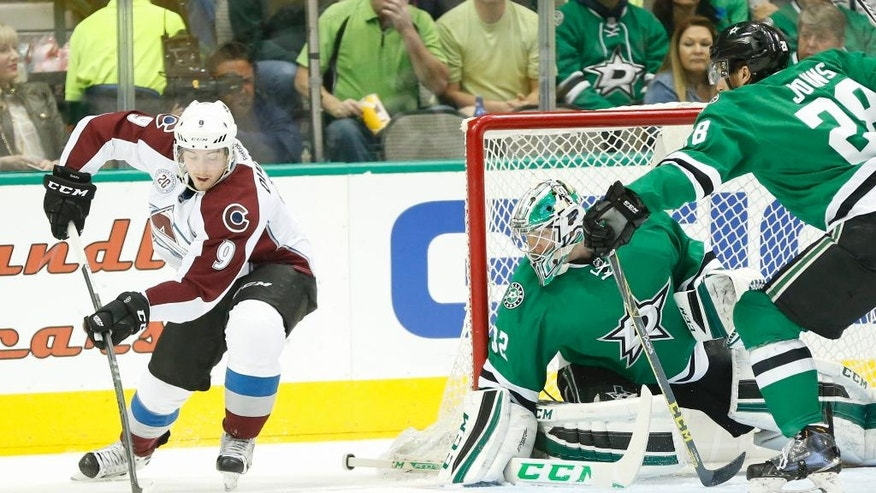 Colorado Avalanche center Matt Duchene (9) attempts a shot on goal against Dallas Stars goalie Kari Lehtonen (32) during the first period of an NHL hockey game, Thursday, April 7, 2016, in Dallas. (AP Photo/Jim Cowsert)