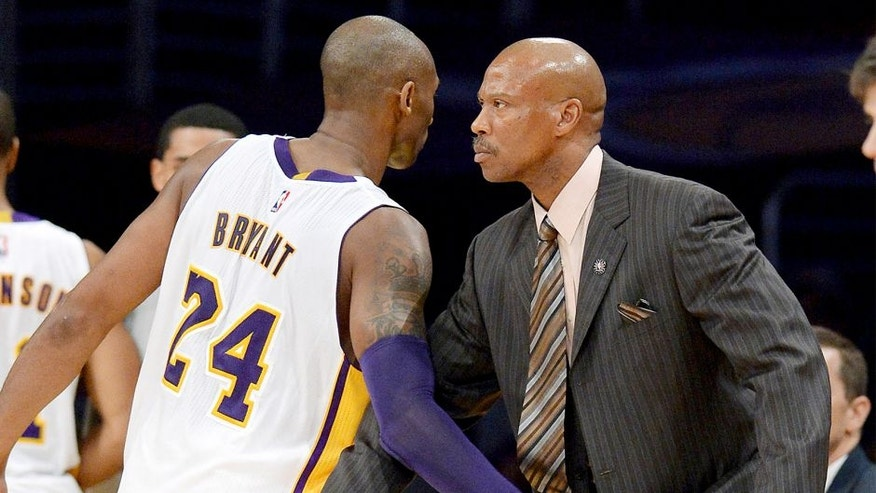 Nov 9, 2014; Los Angeles, CA, USA; Los Angeles Lakers guard Kobe Bryant (24) and head coach Byron Scott in the second half of the game against the Charlotte Hornets at Staples Center. Lakers won 107-92. Mandatory Credit: Jayne Kamin-Oncea-USA TODAY Sports