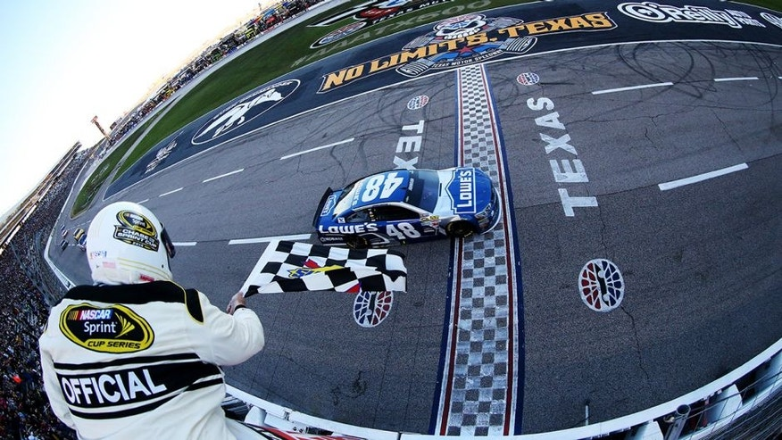 FORT WORTH, TX - NOVEMBER 08: Jimmie Johnson, driver of the #48 Lowe's Chevrolet, takes the checkered flag to win the NASCAR Sprint Cup Series AAA Texas 500 at Texas Motor Speedway on November 8, 2015 in Fort Worth, Texas. (Photo by Sean Gardner/NASCAR via Getty Images)