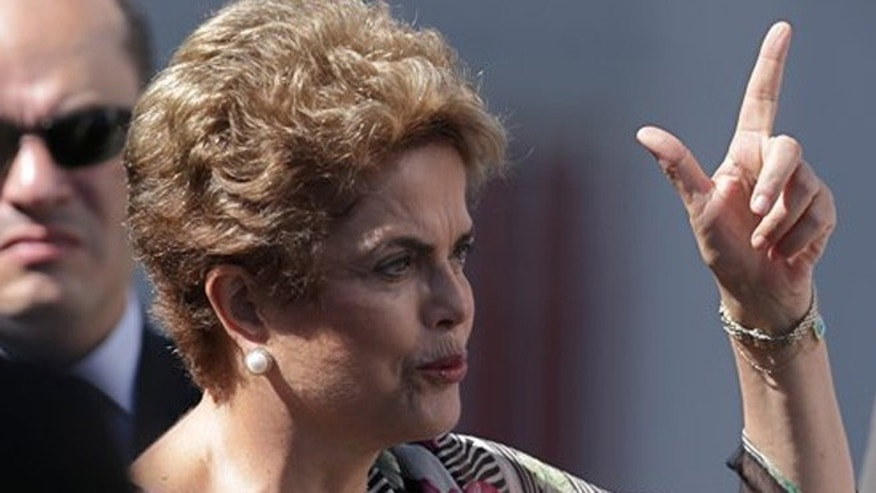 Brazils President Dilma Rousseff speaks during a visit to ground infrastructure works for Geostationary Satellite Operation Defense and Strategic Communications for the 2016 Olympic Games, in Brasilia, Brazil, Wednesday, March 23, 2016. Brazil's economic and political crisis has relegated Rio de Janeiro's Olympic preparations to an afterthought with South America's first games just over four months away. (AP Photo/Eraldo Peres)