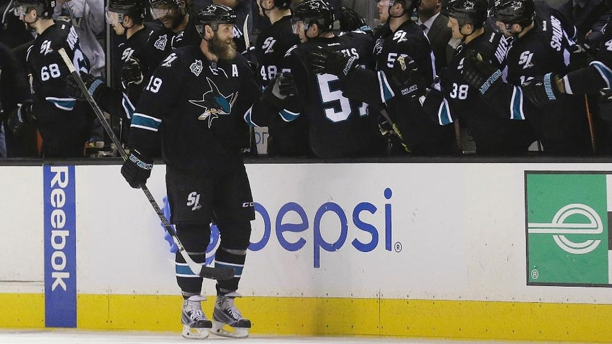 San Jose Sharks center Joe Thornton (19) celebrates with teammates after scoring against the Winnipeg Jets during the second period of an NHL hockey game in San Jose, Calif., Thursday, April 7, 2016. (AP Photo/Jeff Chiu)