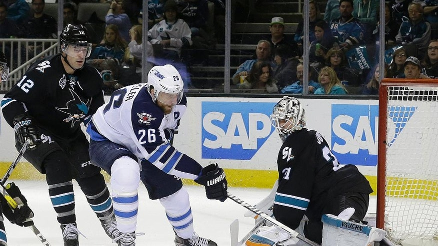 Winnipeg Jets right wing Blake Wheeler (26) scores a goal past San Jose Sharks goalie Martin Jones during the second period of an NHL hockey game in San Jose, Calif., Thursday, April 7, 2016. (AP Photo/Jeff Chiu)