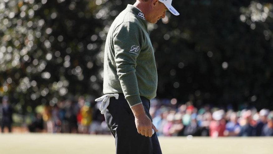 Ernie Els, of South Africa looks down as he three-putts the first hole during the second round of the Masters golf tournament Friday, April 8, 2016, in Augusta, Ga. (AP Photo/Chris Carlson)