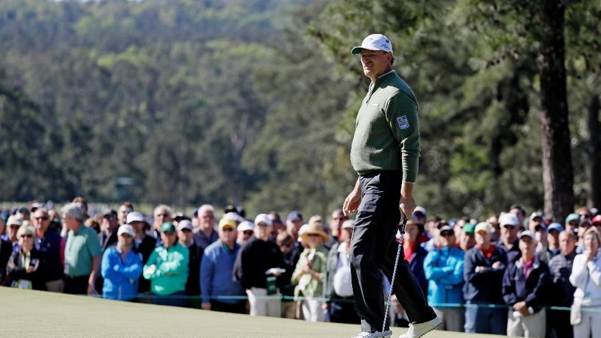 Ernie Els, of South Africa, watches a putt on the first hole during the second round of the Masters golf tournament Friday, April 8, 2016, in Augusta, Ga. (AP Photo/Chris Carlson)