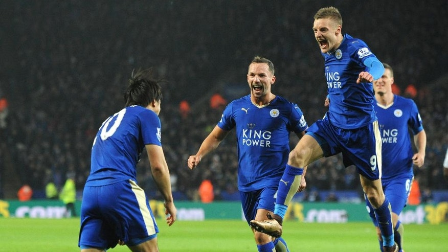 FILE- In this Monday, March 14, 2016 file photo, Leicester's Shinji Okazaki, left, celebrates with teammates Jamie Vardy, right, and Daniel Drinkwater, after scoring during the English Premier League soccer match between Leicester City and Newcastle United at the King Power Stadium in Leicester, England. (AP Photo/Rui Vieira)